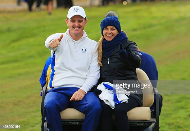 Justin Rose of Europe and wife Kate Rose give the thumbs up after his match was halved during the Afternoon Foursomes of the 2014 Ryder Cup on the...