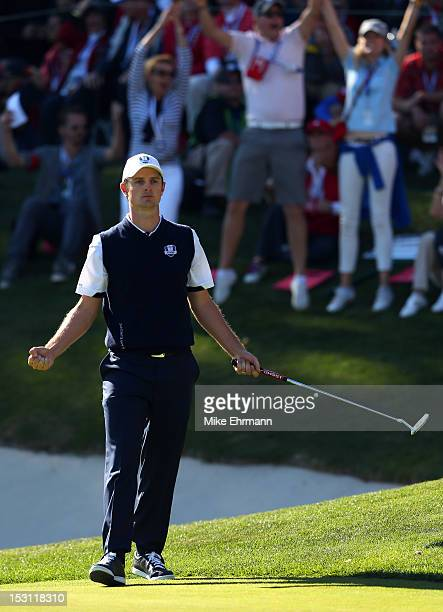 Justin Rose of Europe celebrates a birdie putt on the 17th green during the Singles Matches for The 39th Ryder Cup at Medinah Country Club on...