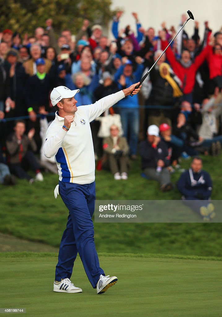 Justin Rose of Europe celebrates as he halves his match on the 18th green during the Afternoon Foursomes of the 2014 Ryder Cup on the PGA Centenary course at the Gleneagles Hotel on September 27, 2014 in Auchterarder, Scotland.