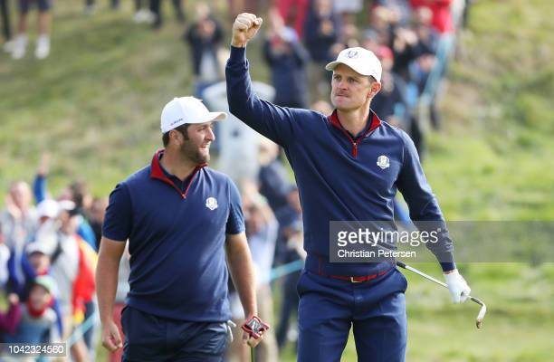 Justin Rose of Europe celebrates chiping in on the 12th during the morning fourball matches of the 2018 Ryder Cup at Le Golf National on September 28...