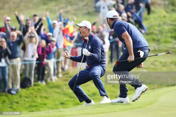 Justin Rose of Europe celebrates chiping in on the 12th during the morning fourball matches of the 2018 Ryder Cup at Le Golf National on September...