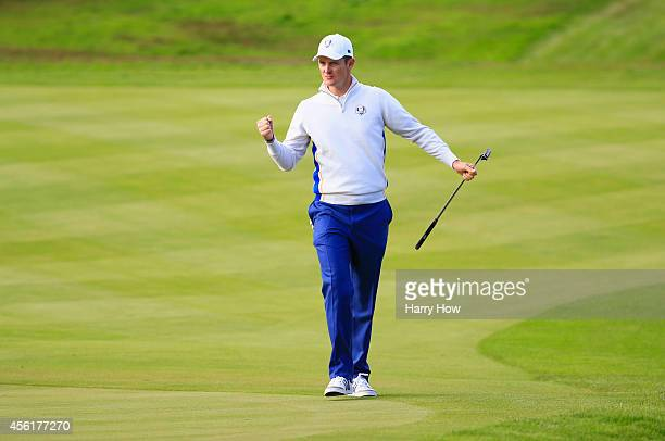 Justin Rose of Europe celebrates his birdie putt on the 10th hole during the Morning Fourballs of the 2014 Ryder Cup on the PGA Centenary course at...