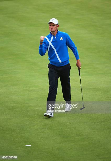 Justin Rose of Europe celebrates his putt on the 12th green during the Afternoon Foursomes of the 2014 Ryder Cup on the PGA Centenary course at the...