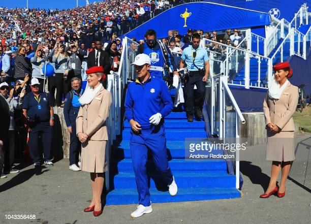 Justin Rose of Europe makes his way to the first tee during singles matches of the 2018 Ryder Cup at Le Golf National on September 30 2018 in Paris...
