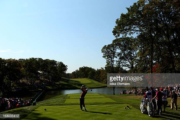 Justin Rose of Europe plays off the 14th tee during day two of the Morning Foursome Matches for The 39th Ryder Cup at Medinah Country Club on...