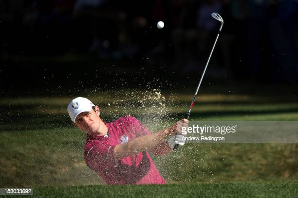 Justin Rose of Europe plays out of the bunker on the 14th green during day two of the Morning Foursome Matches for The 39th Ryder Cup at Medinah...