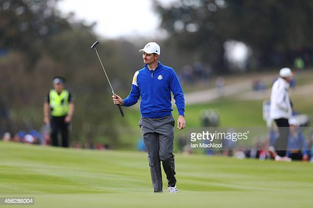 Justin Rose of Europe salutes the crowd on the 7th during the Singles Matches of the 2014 Ryder Cup on the PGA Centenary course at the Gleneagles...