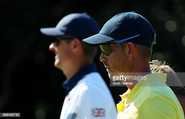Justin Rose of Great Britain and Henrik Stenson of Sweden walk on the 13th hole during the final round of men's golf on Day 9 of the Rio 2016 Olympic...