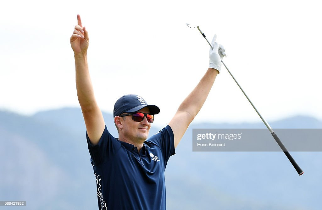 Justin Rose of Great Britain celebrates after hitting a hole in one on the fourth hole during the first round of men's golf on Day 6 of the Rio 2016 Olympics at the Olympic Golf Course on August 12, 2016 in Rio de Janeiro, Brazil.