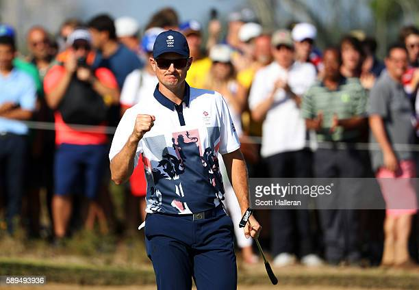 Justin Rose of Great Britain celebrates his birdie on the 15th green during the final round of men's golf on Day 9 of the Rio 2016 Olympic Games at...