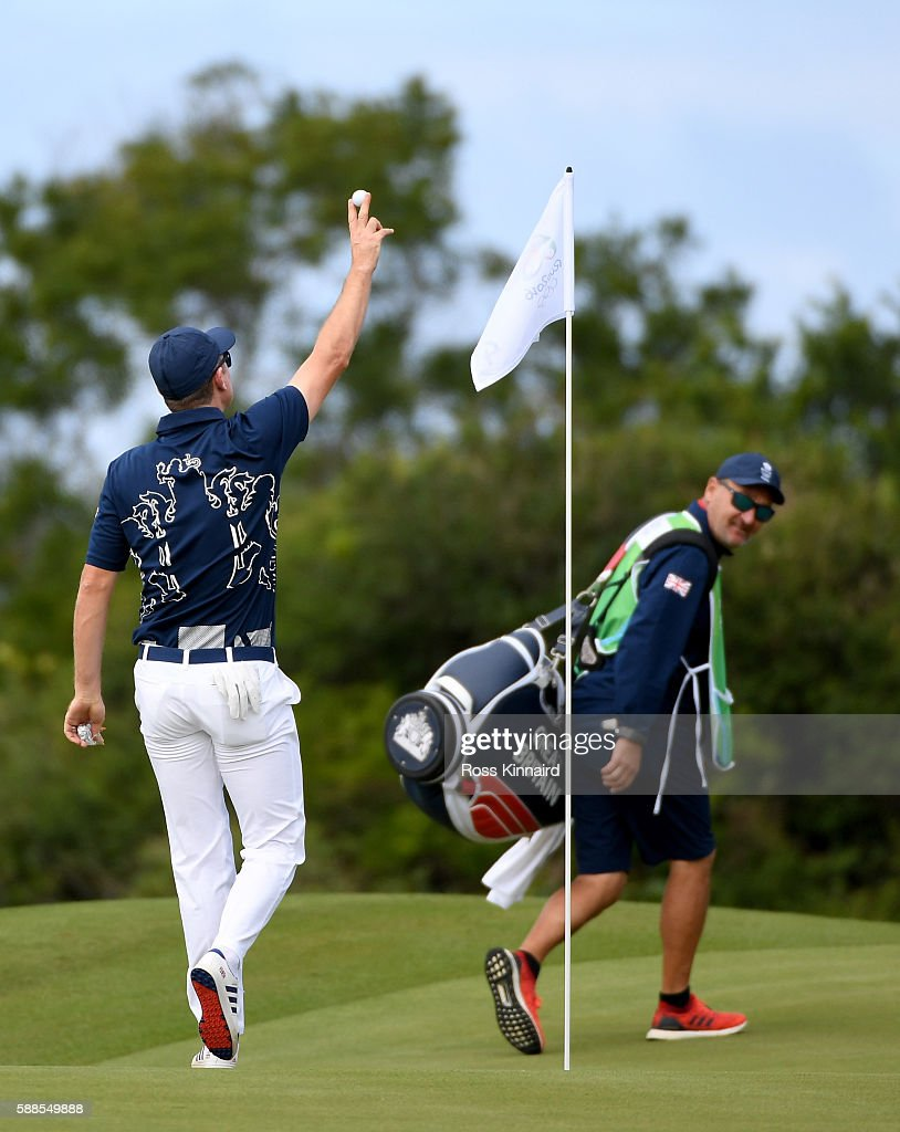 Justin Rose of Great Britain celebrates his hole-in-one on the par four 4th hole during the first round of men's golf on Day 6 of the Rio 2016 Olympics at the Olympic Golf Course on August 12, 2016 in Rio de Janeiro, Brazil.