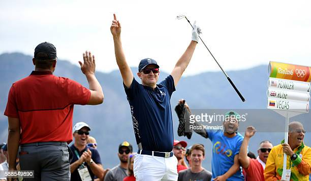 Justin Rose of Great Britain celebrates his holeinone on the par four 4th hole during the first round of men's golf on Day 6 of the Rio 2016 Olympics...