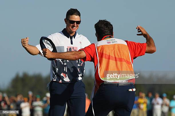 Justin Rose of Great Britain celebrates with caddie Mark Fulcher after winning in the final round of men's golf on Day 9 of the Rio 2016 Olympic...