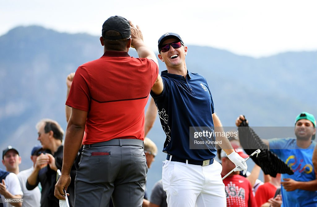 Justin Rose of Great Britain celebrates with Jhonattan Vegas of Venezuela after hitting a hole in one on the fourth hole during the first round of men's golf on Day 6 of the Rio 2016 Olympics at the Olympic Golf Course on August 12, 2016 in Rio de Janeiro, Brazil.