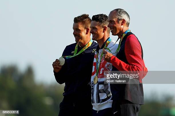 Justin Rose of Great Britain celebrates with the gold medal Henrik Stenson of Sweden silver medal and Matt Kuchar of the United States bronze medal...