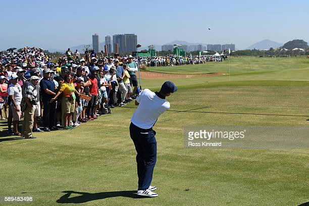 Justin Rose of Great Britain plays a shot on the seventh hole during the final round of men's golf on Day 9 of the Rio 2016 Olympic Games at the...