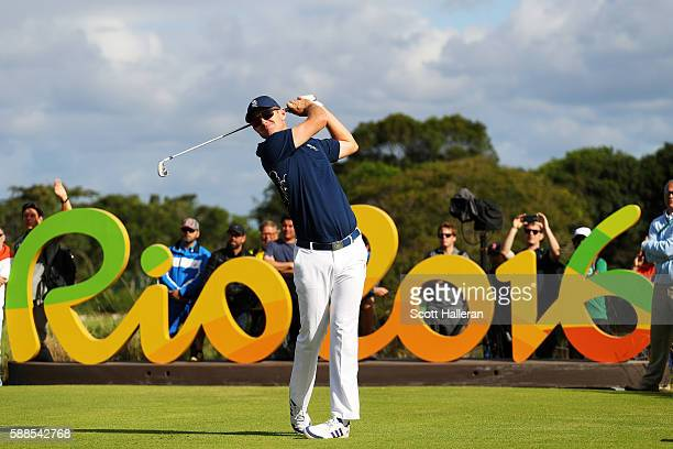 Justin Rose of Great Britain plays his shot from the 16th tee during the first round of men's golf on Day 6 of the Rio 2016 Olympics at the Olympic...