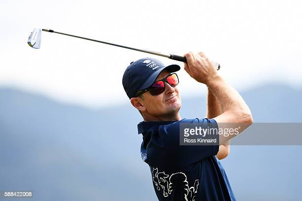 Justin Rose of Great Britain plays his shot from the fourth tee for a hole in one during the first round of men's golf on Day 6 of the Rio 2016...