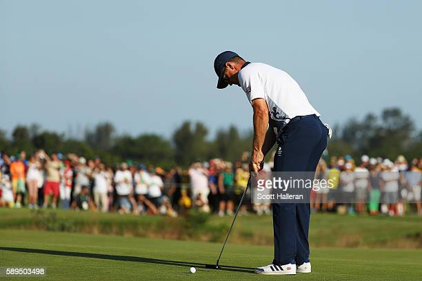 Justin Rose of Great Britain putts on the 18th green to win in the final round of men's golf on Day 9 of the Rio 2016 Olympic Games at the Olympic...