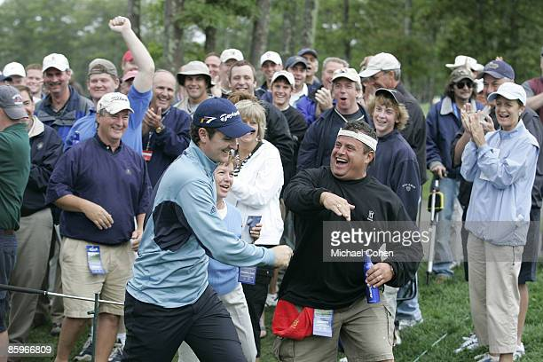 Justin Rose reacts to the gallery after holing out his recovery shot on the par 3 16th hole for a birdie during the second round of the 2006 Deutsche...