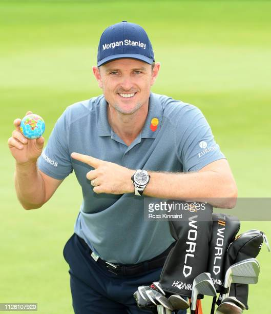 Justin Rose the 'World Number One' poses with a mini globe during the proam event prior to the Saudi International at the Royal Greens Golf Country...