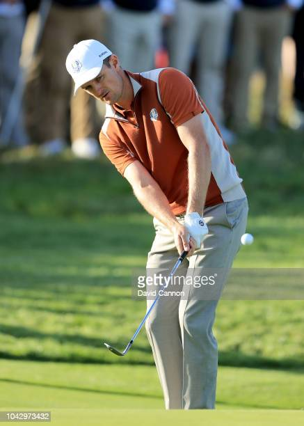 Justin Rosed of England and the European Team plays his third shot on the 17th hole in his match with Henrik Stenson against Brooks Koepka and Dustin...