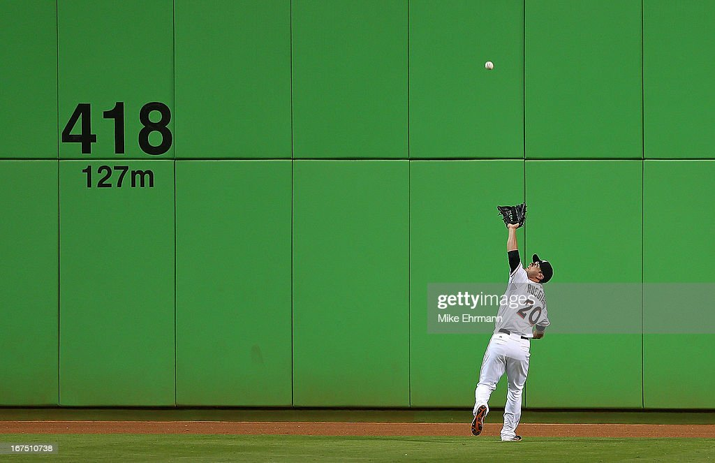 Justin Ruggiano #20 of the Miami Marlins makes a catch during a game against the Chicago Cubs at Marlins Park on April 25, 2013 in Miami, Florida.
