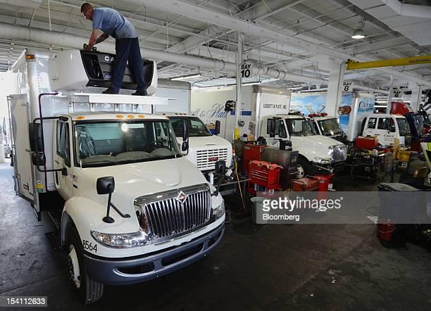 Justin Sabljak a refrigeration specialist installs a Carrier refrigeration unit at Rechtien International Trucks Inc in Miami Florida US on Friday...