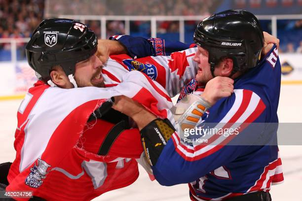 Justin Sawyer of Canada and Kip Brennan of the USA fight during the International Ice Hockey Invitational match between Canada and the USA at Perth...
