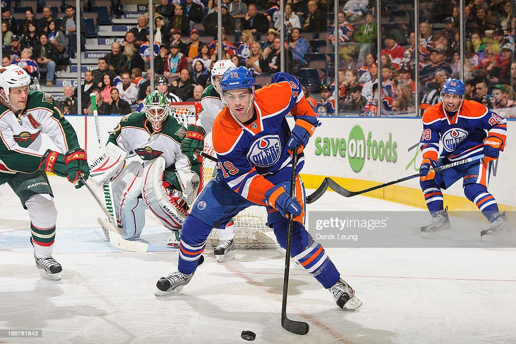 Justin Schultz #19 of the Edmonton Oilers chases the puck during the game against the Minnesota Wild during an NHL game at Rexall Place on April 16, 2013 in Edmonton, Alberta, Canada.