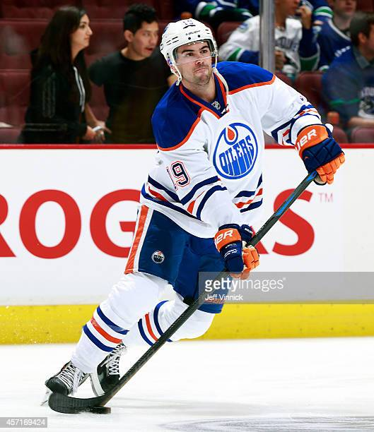 Justin Schultz of the Edmonton Oilers skates up ice with the puck during their NHL game against the Vancouver Canucks at Rogers Arena October 11,...