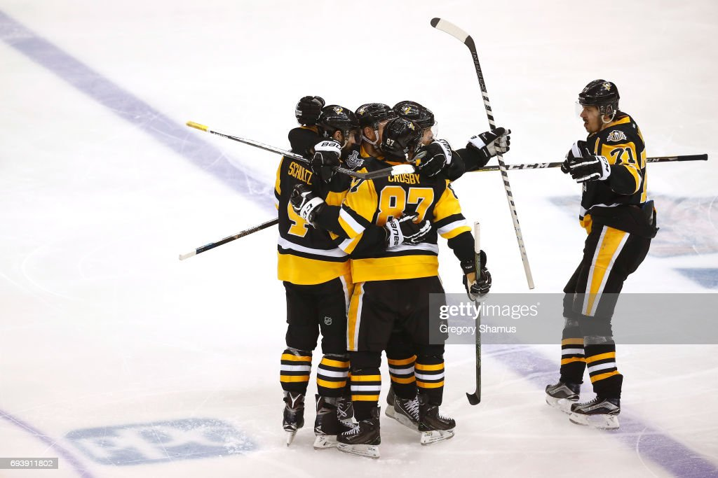Justin Schultz #4 of the Pittsburgh Penguins celebrates after scoring a goal in the first period against the Nashville Predators in Game Five of the 2017 NHL Stanley Cup Final at PPG PAINTS Arena on June 8, 2017 in Pittsburgh, Pennsylvania.