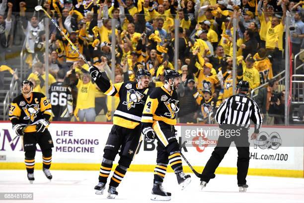 Justin Schultz of the Pittsburgh Penguins celebrates with his teammates after scoring a goal against Craig Anderson of the Ottawa Senators during the...