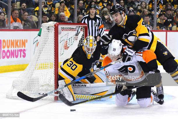 Justin Schultz of the Pittsburgh Penguins checks Nolan Patrick of the Philadelphia Flyers to the ice at PPG PAINTS Arena on March 25 2018 in...