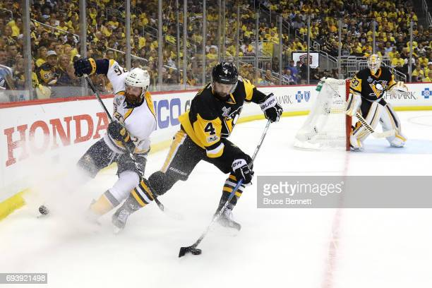 Justin Schultz of the Pittsburgh Penguins controls the puck against Harry Zolnierczyk of the Nashville Predators in the second period in Game Five of...