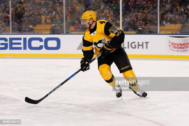 Justin Schultz of the Pittsburgh Penguins controls the puck during the game against the Philadelphia Flyers at Heinz Field on February 25 2017 in...