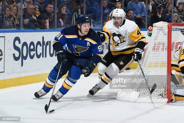 Justin Schultz of the Pittsburgh Penguins defends against Vladimir Tarasenko of the St Louis Blues at Scottrade Center on February 11 2018 in St...
