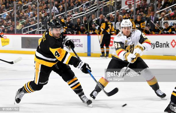 Justin Schultz of the Pittsburgh Penguins shoots the puck against Jonathan Marchessault of the Vegas Golden Knights at PPG Paints Arena on February 6...