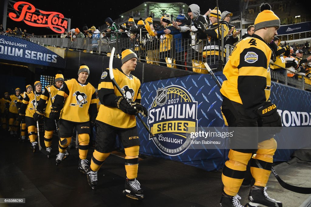 Justin Schultz #4, Steve Oleksy #61, Chad Ruhwedel #2 and their Pittsburgh Penguins teammates make their way to the ice surface for warm-up prior to the 2017 Coors Light NHL Stadium Series at Heinz Field on February 25, 2017 in Pittsburgh, Pennsylvania.