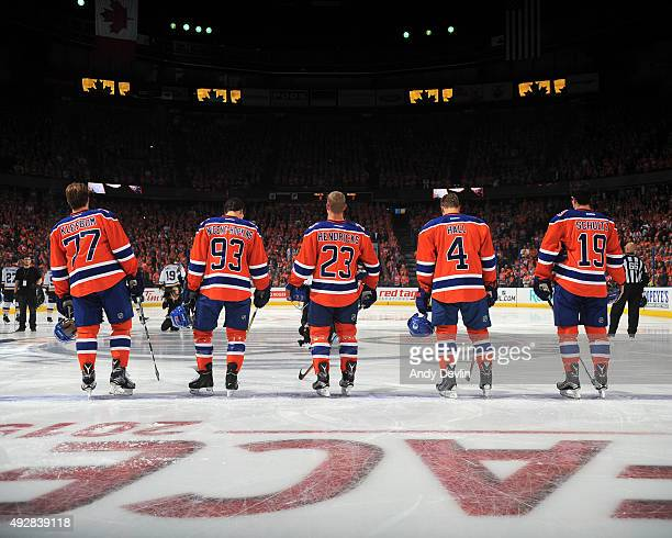 Justin Schultz Taylor Hall Matt Hendricks Ryan NugentHopkins and Oscar Klefbom of the Edmonton Oilers standsfor the singing of the national anthem...