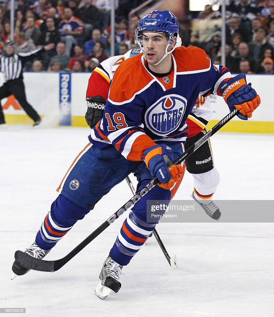 Justin Schutz #19 of the Edmonton Oilers follows the playtagainst the Calgary Flames at Rexall Place on April 1, 2013 in Edmonton, Alberta, Canada.