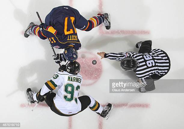 Justin Scott of the Barrie Colts takes a faceoff against Mitchell Marner of the London Knights in an OHL game at the Budweiser Gardens on October 10,...