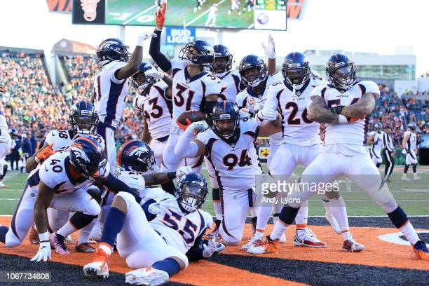 Justin Simmons of the Denver Broncos celebrates with his teammates after intercepting a pass during the third quarter of the game against the...
