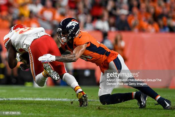 Justin Simmons of the Denver Broncos tackles LeSean McCoy of the Kansas City Chiefs during the first quarter on Thursday, October 17, 2019.