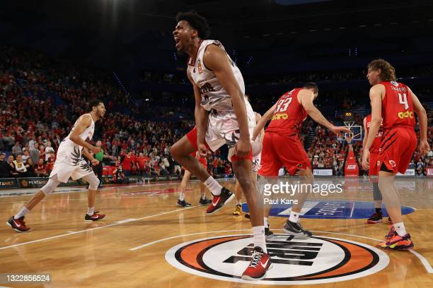 Justin Simon of the Hawks celebrates a basket late in the final quarter during game one of the NBL Semi-Final Series between the Perth Wildcats and...