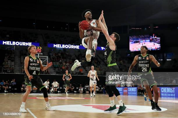 Justin Simon of the Hawks drives at the basket during the NBL Cup match between the South East Melbourne Phoenix and the Illawarra Hawks at John Cain...