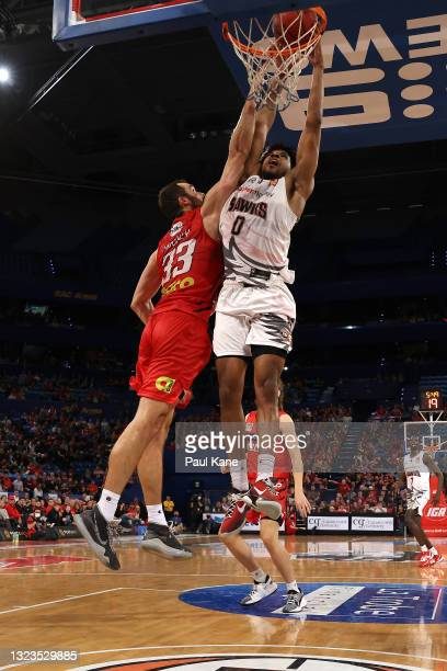Justin Simon of the Hawks dunks the ball during game three of the NBL Semi-Final Series between the Perth Wildcats and the Illawarra Hawks at RAC...