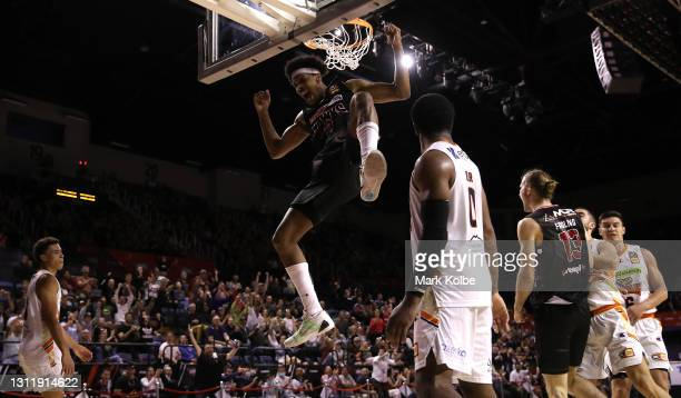 Justin Simon of the Hawks reacts after a slam dunk during during the round 13 NBL match between the Illawarra Hawks and the Cairns Taipans at WIN...