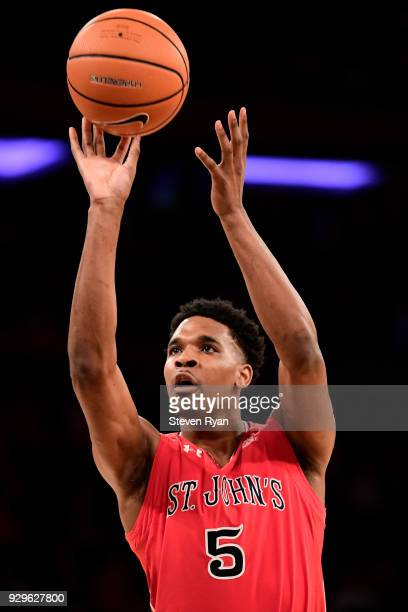 Justin Simon of the St John's Red Storm attempts a free throw against the Georgetown Hoyas during the first round of the Big East tournament at...