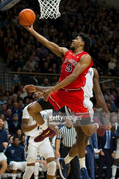 Justin Simon of the St John's Red Storm attempts a lay up against Eric Paschall of the Villanova Wildcats in the first half at Finneran Pavilion on...